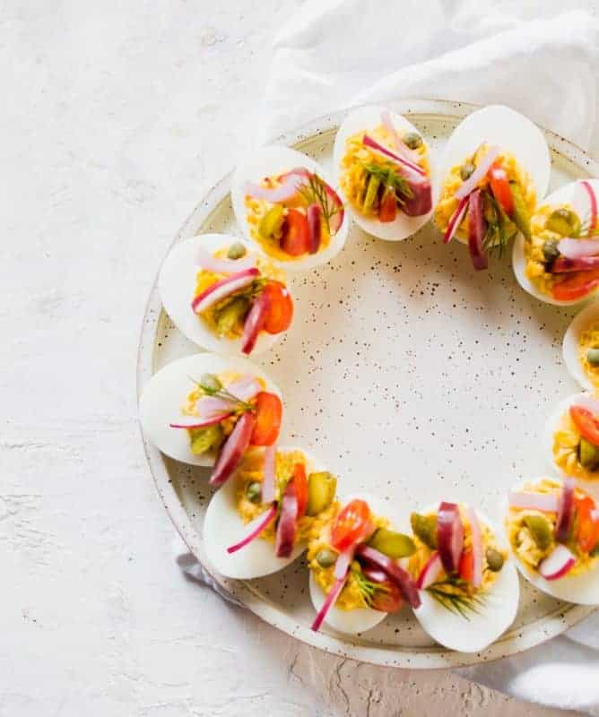 These FULLY LOADED KETO DEVILED EGGS are the perfect twist on the classic deviled eggs. The perfect bite of savory, pickled, sweet and smokey. #deviledeggs #keto #lowcarb #eggs #appetizer