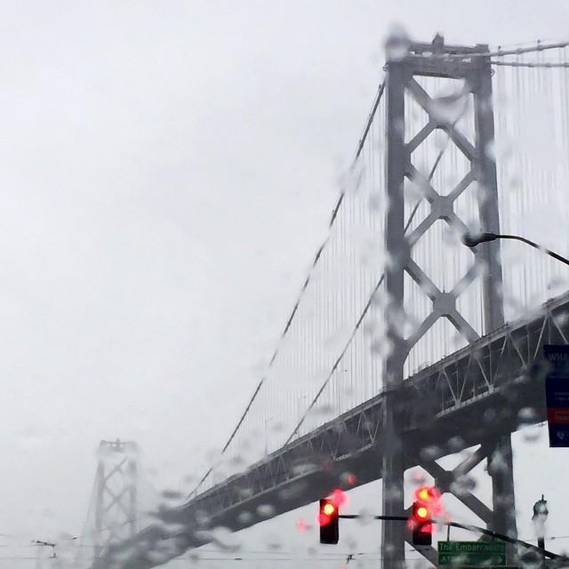 #goldengatebridge driving in this morning using #lyft I snapped this sweet photo of the rainy morning drive. #sanfrancisco #airbnbopen #airbnbsanfrancisco #airbnbopenconference #airbnb #community #rain #bridge #lenaskitchenblog #fog #rainy @airbnb @lyft
