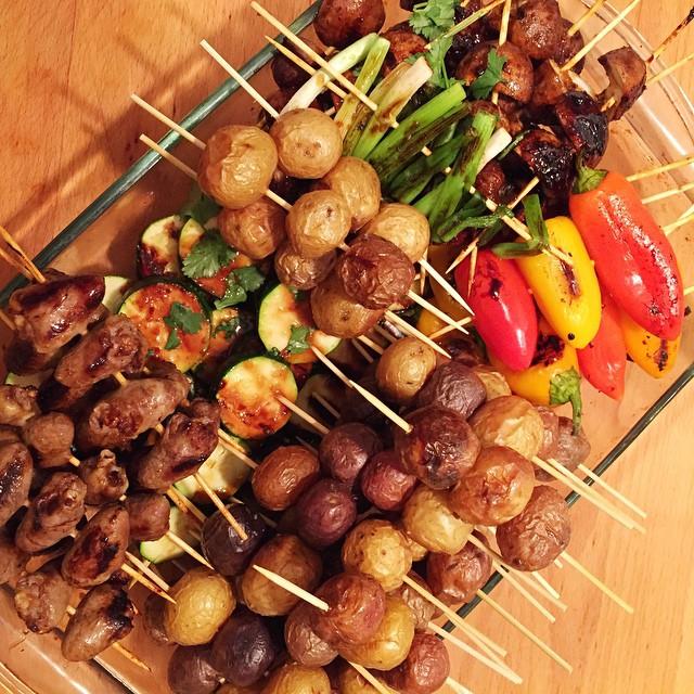 Food on sticks themed potluck. I brought a variety of grilled veggies and chicken hearts. #veggies #sticks #mushrooms #bellpeppers #zucchini #chickenhearts #greenonions #grilled #foodonsticks #yumm #food #f52grams #foodstagram #foodphotography #lenaskitchen #lenaskitchenblog #chef #cheflife #truecooks #tasty